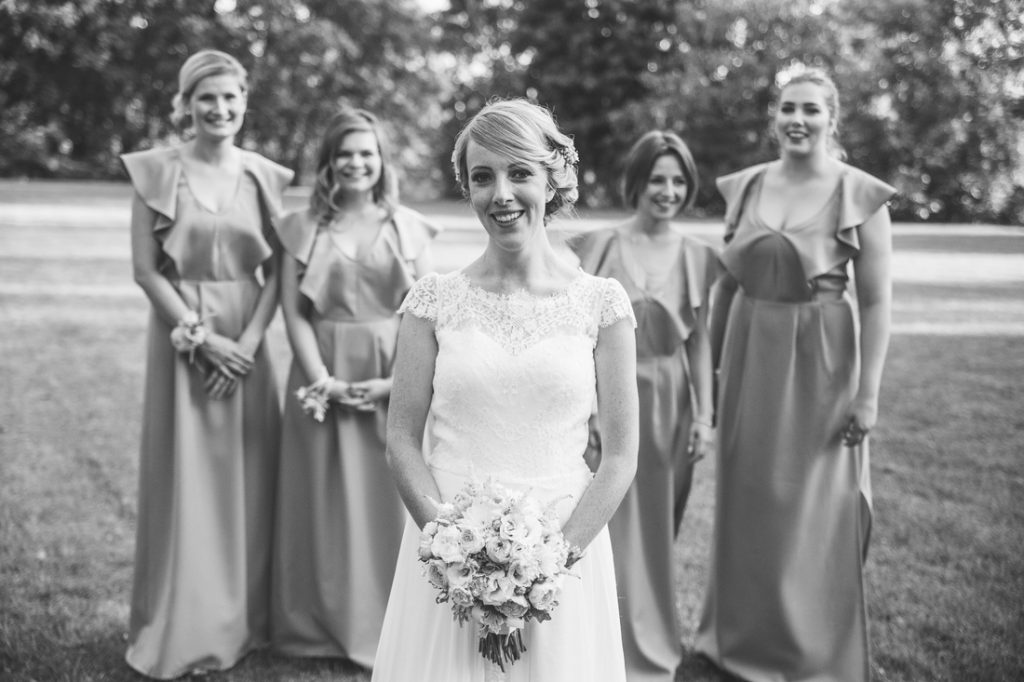 Bride with bridesmaids. Wedding photo. September. Palace of the Opieszyn